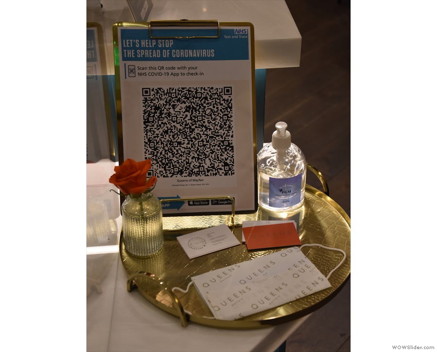 ... sign of the times: the QR Code for the NHS COVID-19 app and some hand sanitiser.