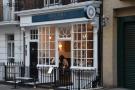 The unassuming façade of Queens of Mayfair. On Queen Street. In Mayfair.