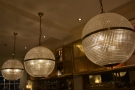 Queens has plenty of impressive light fittings, like these that hang over the counter.