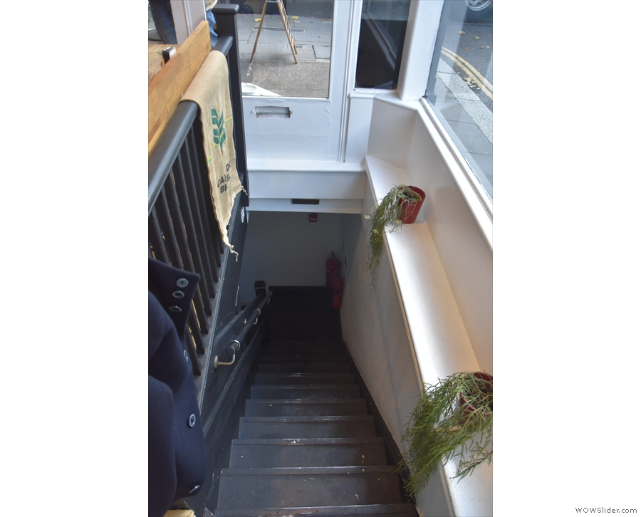 Instead it's beside these stairs, which lead down to the basement, where you'll find...