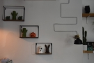 ... while these shelves, and their cactii, are on the wall to the right...
