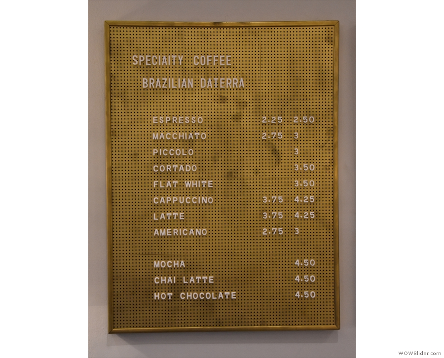 ... with a gold espresso-based menu on the wall.