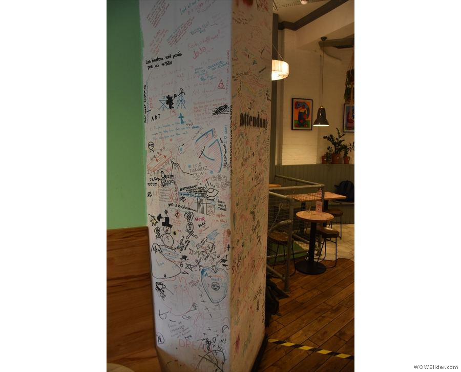 This graffitied pillar marks the boundary between front and back rooms.