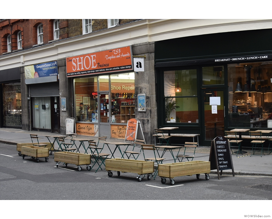 ... outside the windows, there's a new outside seating area on the street itself.