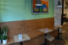 ... this wooden bench and its three well-spaced tables along the left-hand wall.