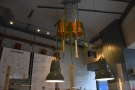 Despite the windows at the front, there are lots of lights. These hang above the counter...