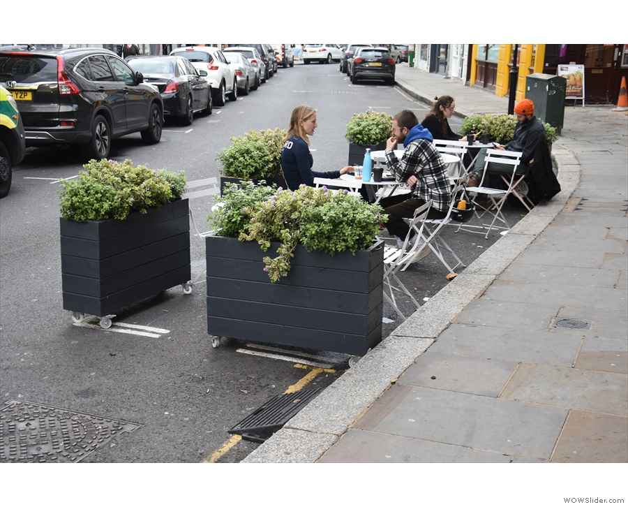 A relatively new addition is this outside seating area, occupynig a pair of parking bays.