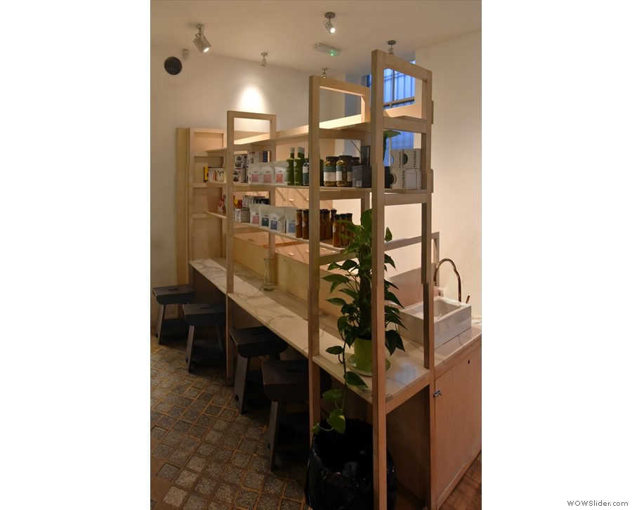 ... with retail shelves behind, where there's a four-person bar below, backs to the counter.
