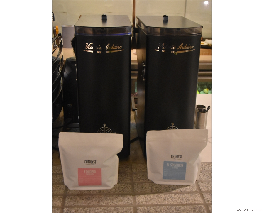 ... the current espresso choices denoted by the bags in front of each grinder.
