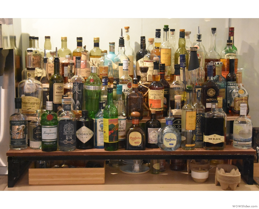 ... behind which you'll find the very well-stocked bar.