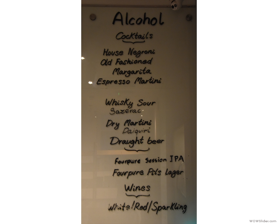 ... while at the right-hand end, far, far away from the bar, is the alcohol menu!