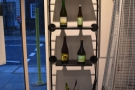 Check out the bottles of wine by the door...