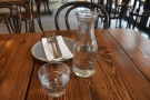 Caravan continues to offer full table service. You get a carafe of water...