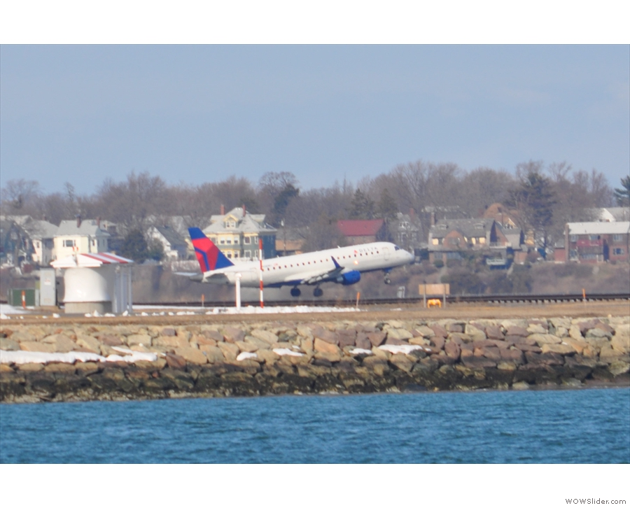 From there I could see the airport and caught this little commuter jet from Delta taking off.