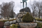 The Minuteman Statue stands across the road, with...