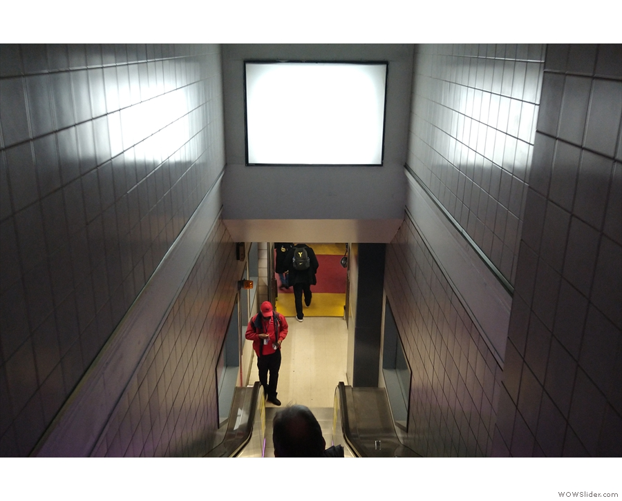 The descent from the concourse to the platform at New York Penn Station. The photo is...