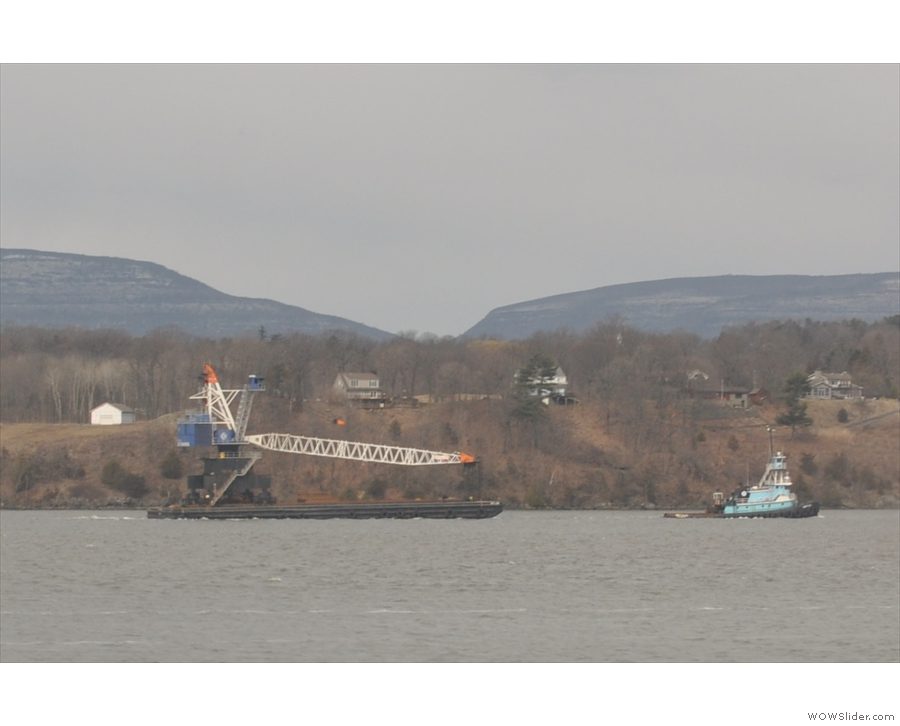 ... althoguh there are other river craft too, like this tug towing a crane.
