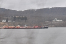 The river is very busy with traffic, mostly barges, going upstream...