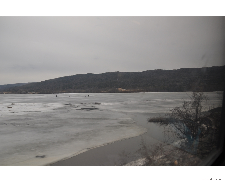 ... western shore of Lake Champlain, a long, thin lake separating New York from Vermont...