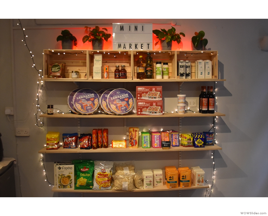 The shelves by the door are a regular mini market, with all sorts of staples...