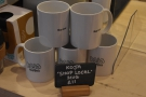 ... while to the left of the till are some branded Koja / Shop Local mugs...