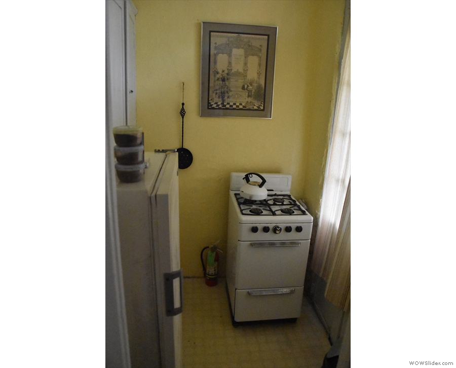 ... and a tiny kitchen with an old gas hob at the front.