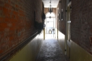 ... led me into a long, narrow passageway (this is the view towards the street).