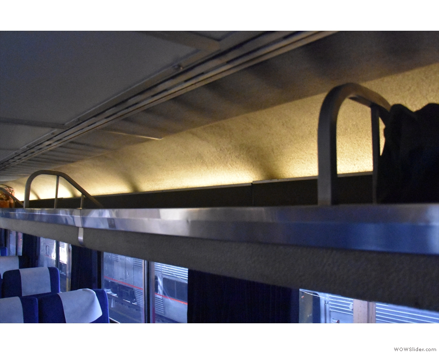 There's plenty of space for luggage on the floor and in overhead luggage racks.