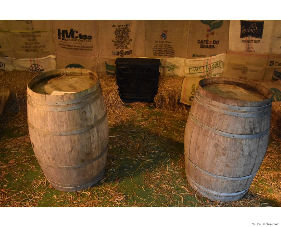 ... barrels for tables and a stove at the far end.