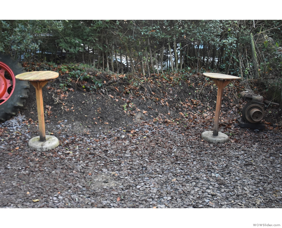 ... or if you prefer to stay outside, there are these two standing tables next to it.