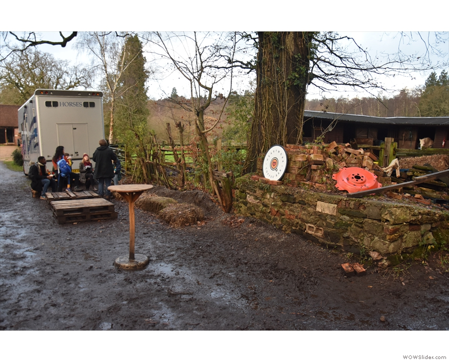 There's more seating opposite the second barn, including another standing table...