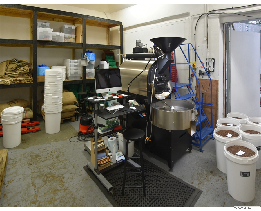 The green beans are stored to one side, with the roaster on the other.