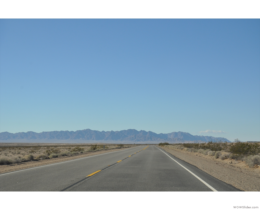 At some point this road will have to turn or we'll go straight into that mountain!