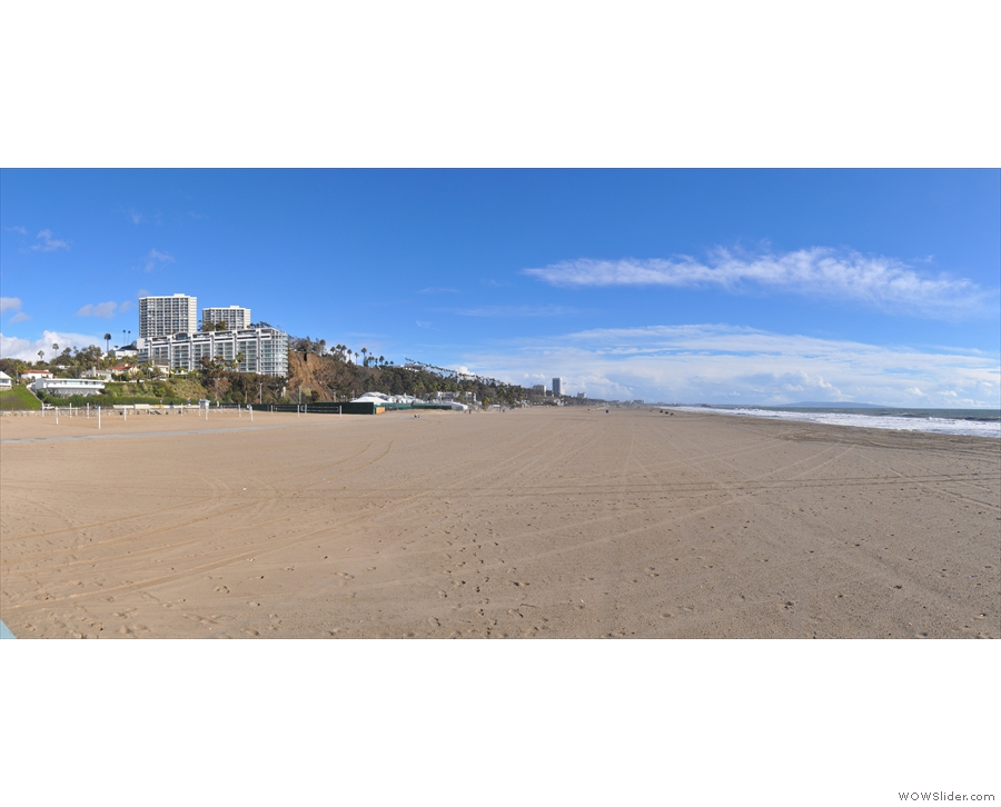 A panoramic view to the south, with the beach front becoming ever more developed...
