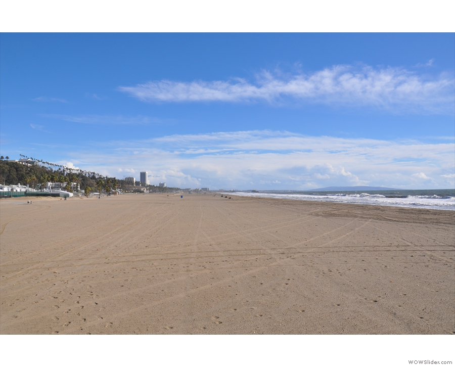 The view along the beach to the south, where, in the distance...
