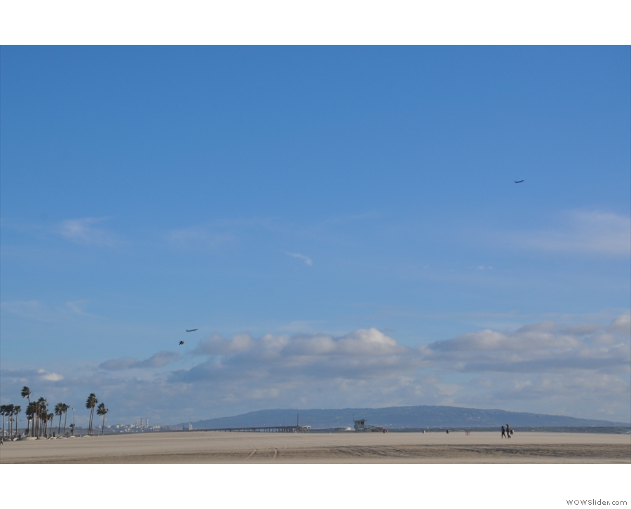 More planes taking off from LAX, with the headland beyond Redondo Beach as a backdrop.