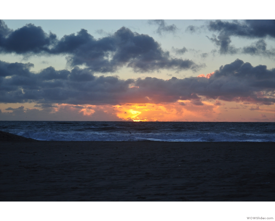 ... and the sun disappearing behind the clouds, which always make a sunset...