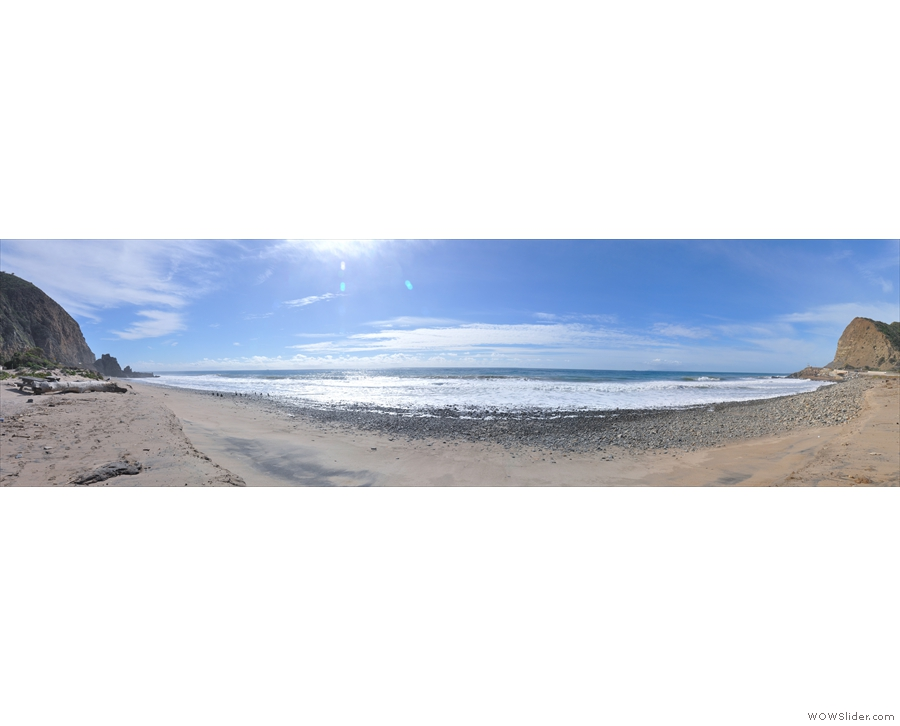 A wide-angle panorama looking out to sea...