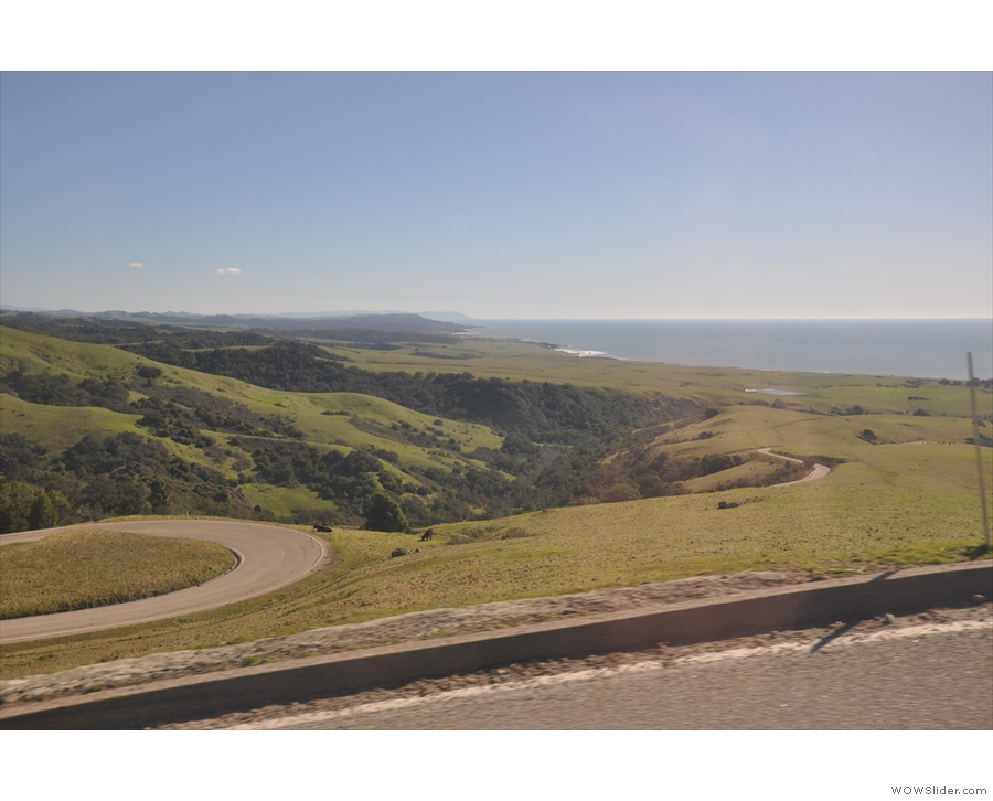 You can see the road as it climbs up the hill, with the coast to the south in the distance.