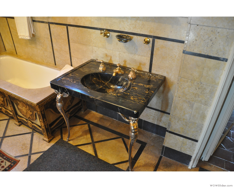 ... along with six bathrooms. Check out that wash basin...