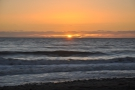 Two of my favourite things: a good sunset and waves breaking on the shore.