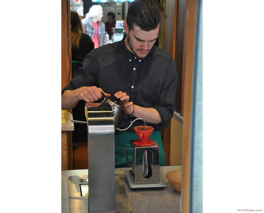 Here Joey is making pour-over for a couple of customers.
