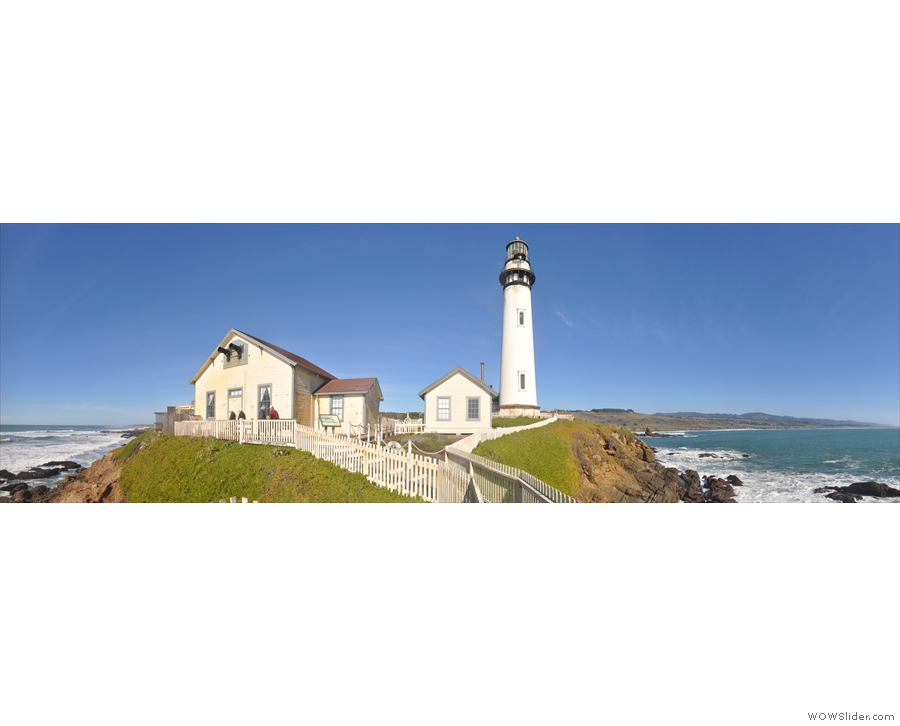 A panorama of the lighthouse and its immediate buildings.