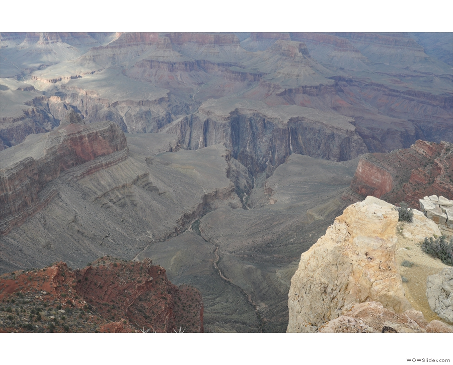 The view directly down on the other side, overlooking a smaller valley, with the canyon...
