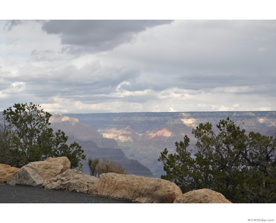 ... that the clouds cast shadows and patches of light on the distant north rim.