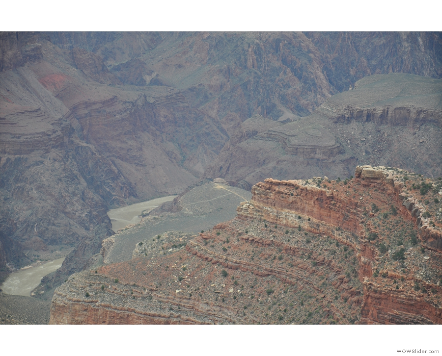 ... of the Colorado River at the bottom of the canyon, with Plateau Point above.