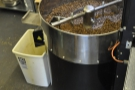 Once the beans have cooled, the second chute is opened to empty the pan.