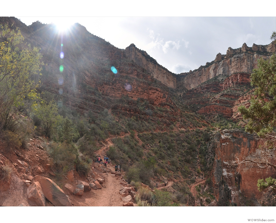 ... back up to the rim, while to the right it continues to descend towards Indian Garden.