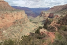 The valley drops steeply away to the left of the trail, which leads straight for...