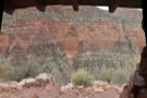 The view out of the window, looking west across the valley to the sandstone cliffs.